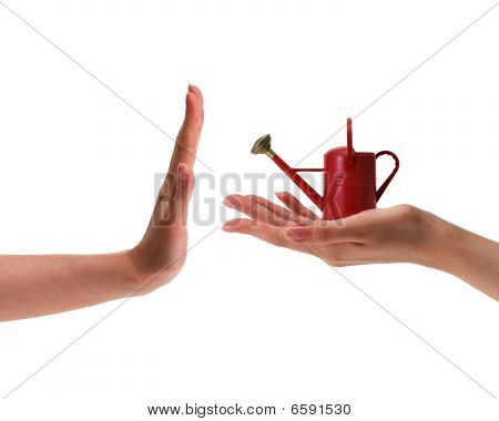 Female Hand Holding Small Red Watering Can
