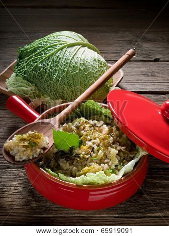 risotto with savoy cabbage in red casserole