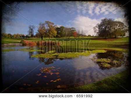 Golf Course Course Park Pond By Trees And Blue Sky