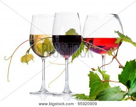 Wine. Three Glasses of wine isolated on white background. Glass of rose, red and white wine decorated with grape leaves. Vine leaf.