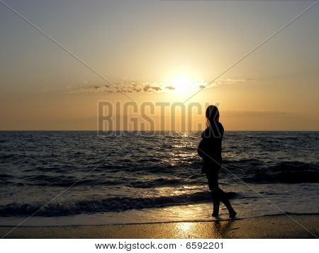 Girl In The Sunset