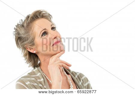 Portrait Of Beautiful Mature Woman Daydreaming Isolated On White Background