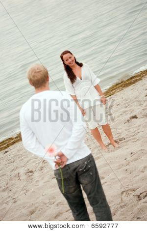 Romantic Man And Woman On The Beach