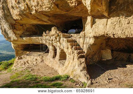 Caves at Tepe Kermen, Crimea, in the morning rays of sunlight