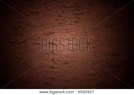 Red stucco wall background with vignette