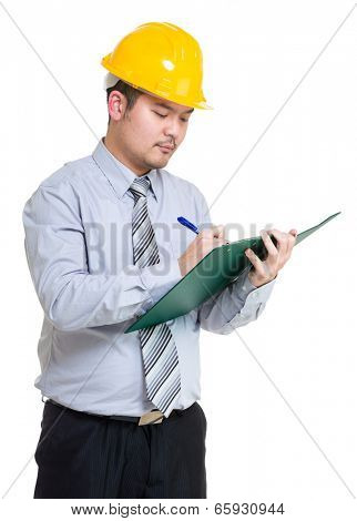 Serious engineer taking note on clipboard