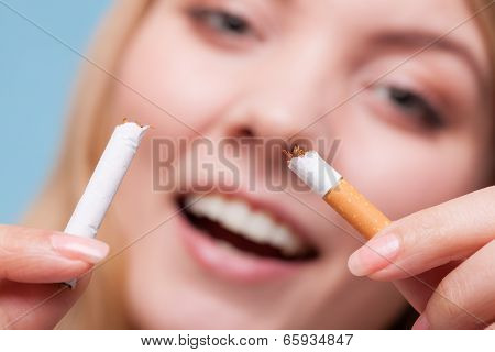 Addiction. Girl Breaking Cigarette. Quit Smoking.