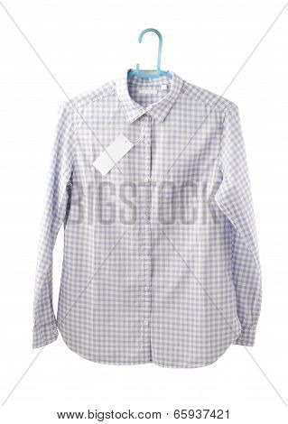 Blue plaid shirt with tag on hanger