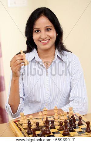 Business Woman Playing Chess