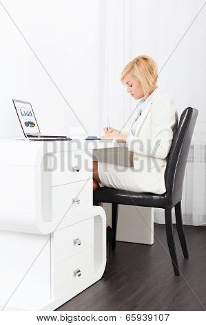 businesswoman writing, signing up paper document