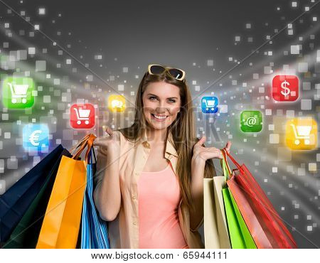 Happy woman shopping online with colorful icons in background