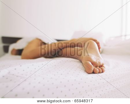 Feet Of A Sleeping Woman