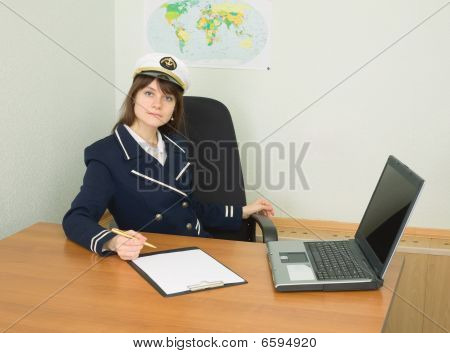 Woman In Uniform Of Sea Captain At Travel Company Office