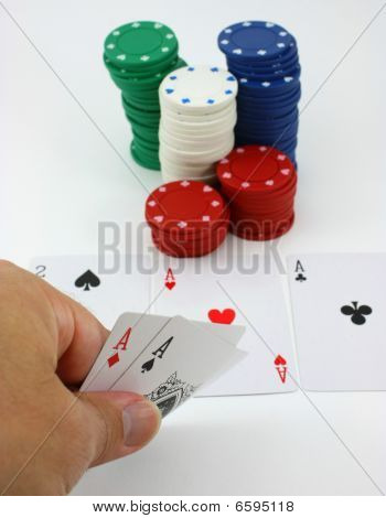 Poker player has pocket aces, four of a kind