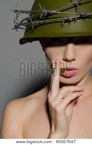 Female Soldier In Helmet Smokes A Bullet