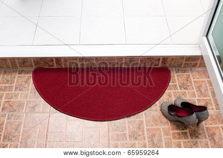 Red doormat for cleaning feet
