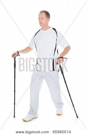 Man Walking With Hiking Pole