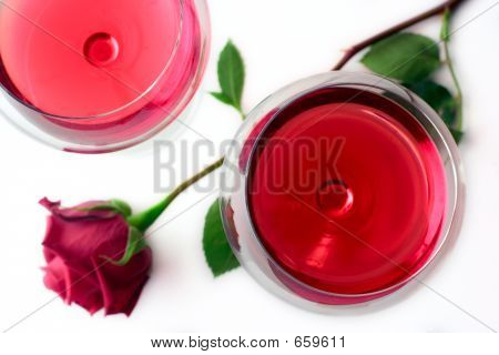 Two wine glasses and a rose