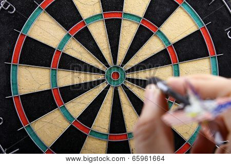 Hand Throwing Dart To Dartboard