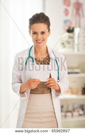 Portrait Of Happy Medical Doctor Woman With Tablet Pc