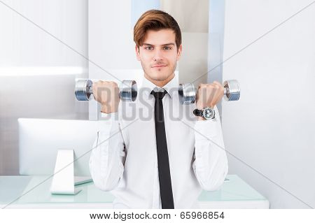 Businessman Exercising With Dumbbells
