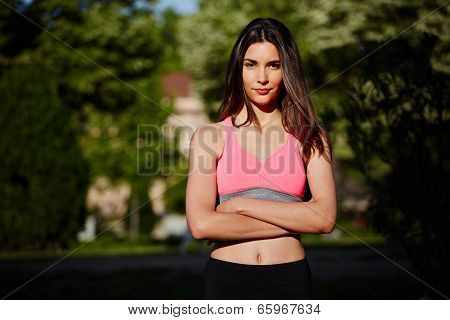 Female jogger with her hands crossed over her chest