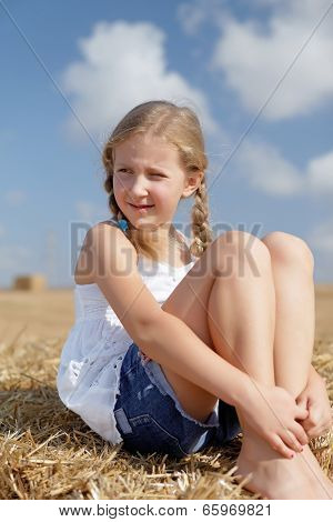Blond Girl On A Haystack