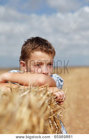 Portrait Of A Boy On The Background Of Rural