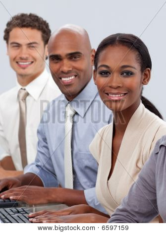 Diverse Confident Business Team Sitting In A Row