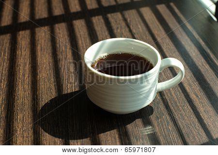 Hot Coffee Cup On Table Near Windows