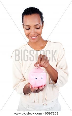 Young Afro-american Businesswoman Saving Money In A Piggybank