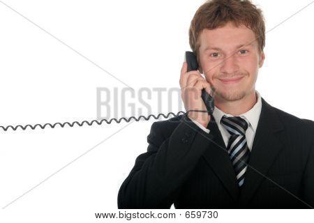 Businessman Holding A Telephone Handset