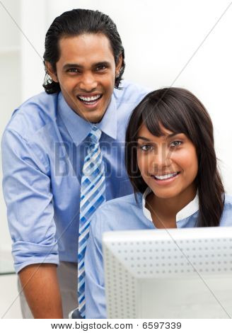 Business Partners Working Together At A Computer