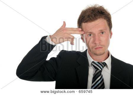 Businessman Holding His Hand To His Head, Mimicking A Gun