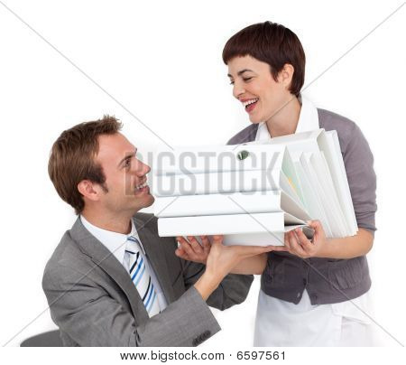 Charming Businesswoman Bringing A Pile Of Folders To Her Colleague