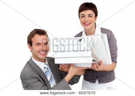 Young Businesswoman Bringing A Pile Of Folders To Her Manager