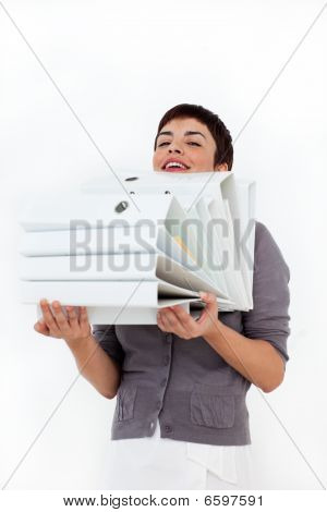 Attractive Businesswoman Carrying A Stack Of Folders