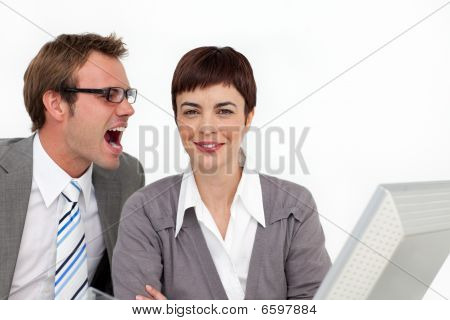 Young Businessman Shouting Into His Colleague's Ear