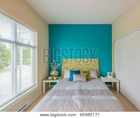 Modern brown bedroom interior in a luxury house with reclaimed wood bedside tables and a beautiful watercolor on the wall