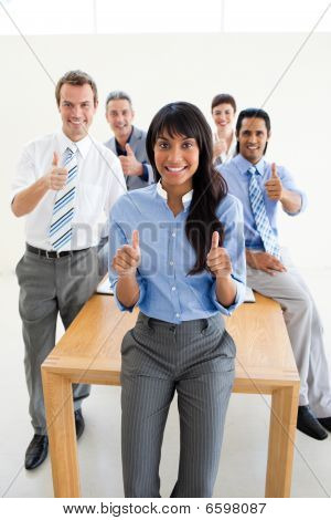 Succesfull Co-workers With Thumbs Up