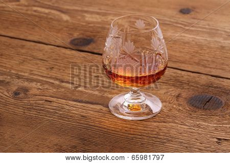 Luxure Cognac In Decorated Crystal Glass On Wood