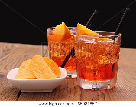 Spritz Aperitif - Two Orange Cocktail With Ice Cubes