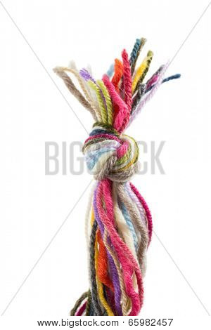 Close up of assorted yarn with knot