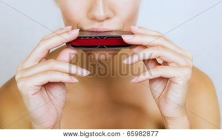 Girl Play Blues Harmonica, Close-up