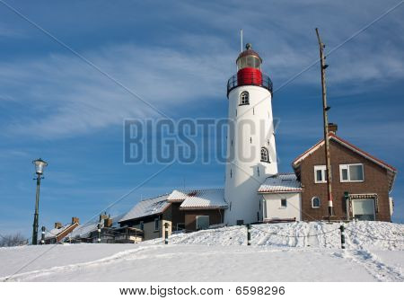 Dutch Lighthouse Of Fishery Village Urk In Wintertime
