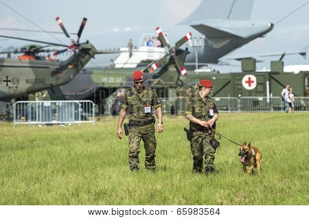 BERLIN, GERMANY - MAY 20, 2014: Unidentified security staff during the International Aerospace Exhibition ILA Berlin Air Show-2014.