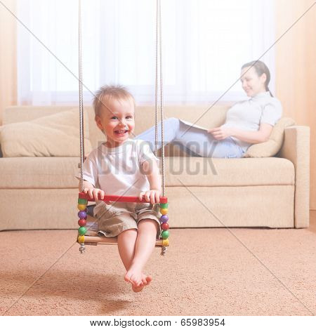 Kid Swinging At Home, Mother Reading