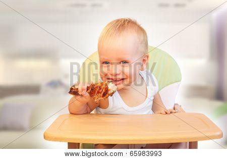 Baby boy eat chiken