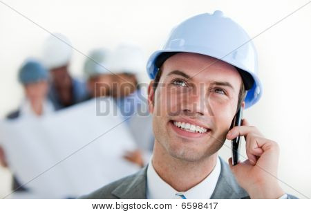 Focus On A Male Architect With A Hardhat On Phone