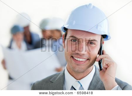 Smiling Architect With A Hardhat On Phone